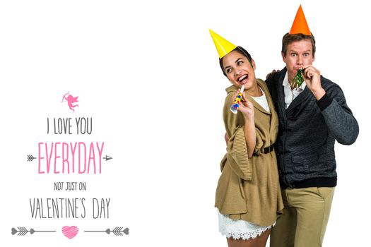 Cheerful couple celebrating birthday against valentines day greeting