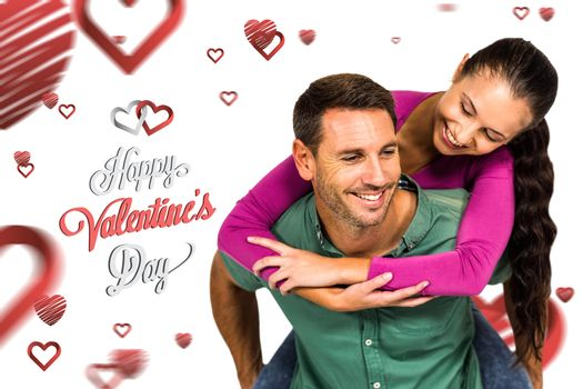 Man with piggy back to his girlfriend  against cute valentines message