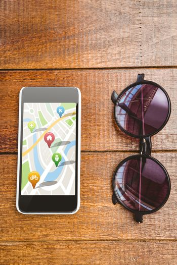 Navigation pointers with various representations on map against view of glasses and a smartphone
