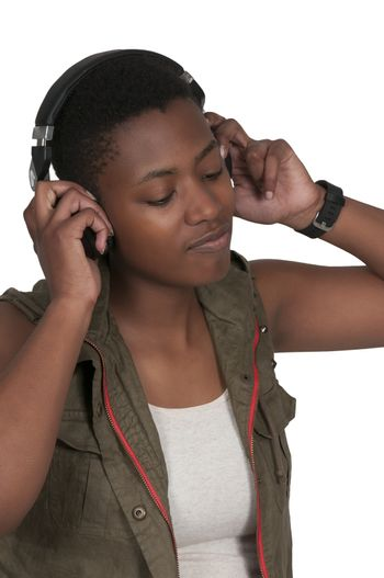 Young Beautiful Woman listening to a set of headphones