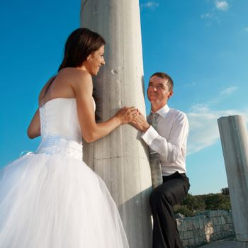 Beautiful wedding couple- bride and groom near greece column in the ancient city