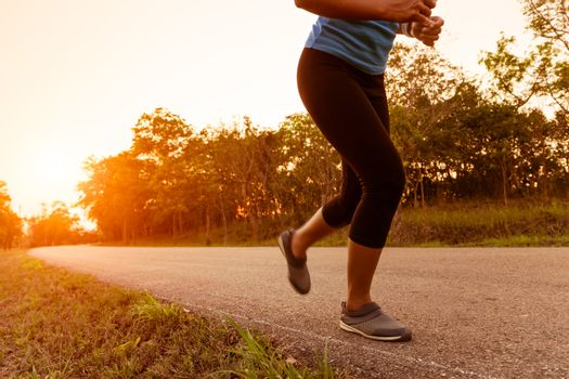 activity woman running on rural road during sunset