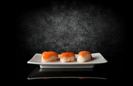 sushi salmon fish rice plate black