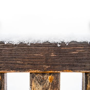 Painted wooden board and rungs covered with snow