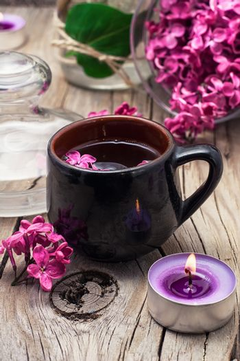 fragrant tea and a branch of lilac
