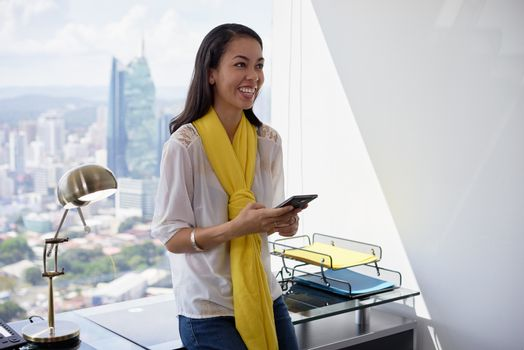 Latina Business Woman Text Messaging On Phone Smiling