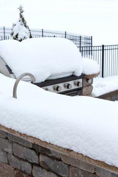 BBQ in Outdoor Kitchen Buried Beneath Winter Snow