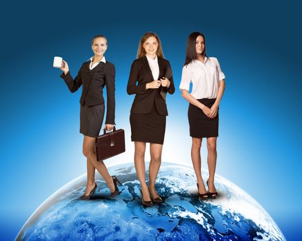 Business ladies on earth on abstract blue background