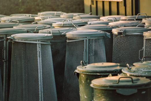 Trash cans piled