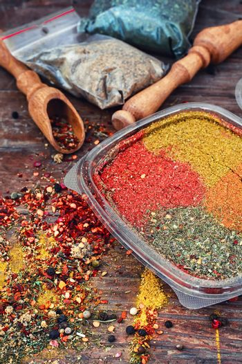 Spicy seasoning on wooden background