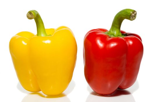 The photograph depicts peppers on a white background