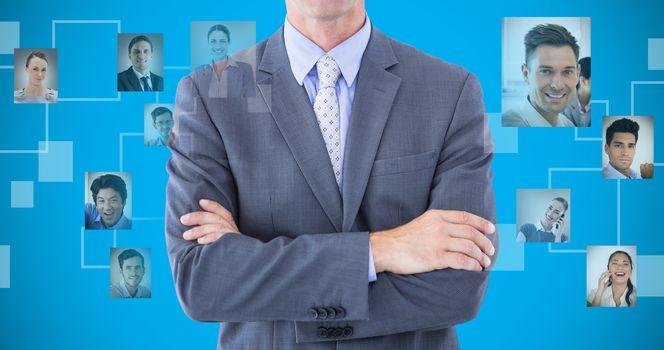Composite image of portrait of smiling businessman standing hands folded