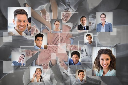 Composite image of smiling business team standing in circle hands together