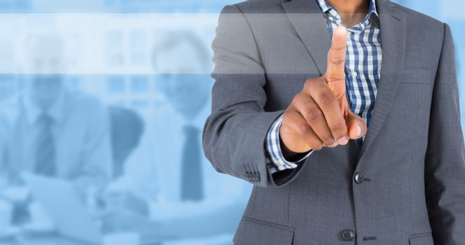 Composite image of focused businessman pointing