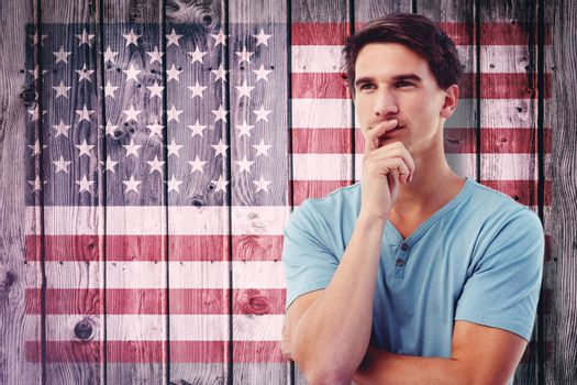 Handsome man thinking against composite image of usa national flag