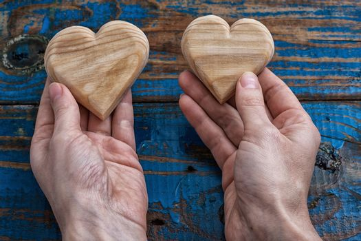 two symbolic wooden heart