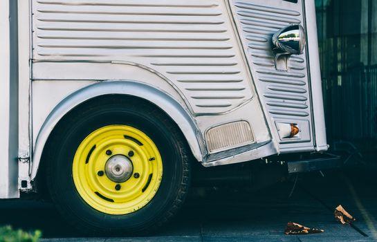 Vintage van detail, bright yellow painted wheel