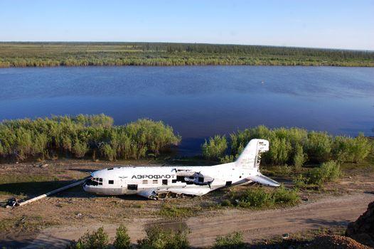 Broken abandoned airplane at Kolyma river coast