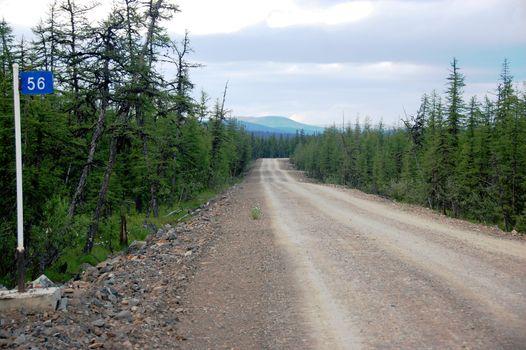 Kilometer post at taiga gravel road