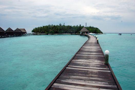 Timber pier at Maldives island resort