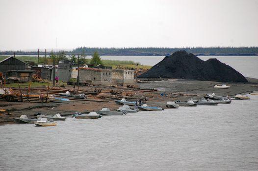 Boats at Kolyma river coast town