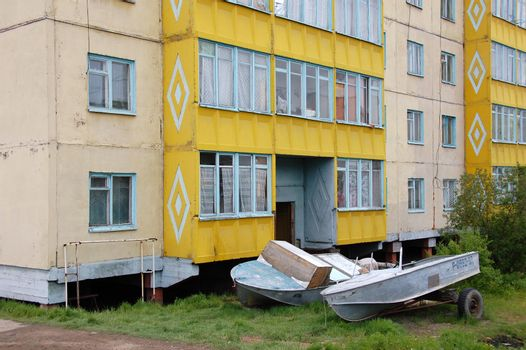 Boats at ground near apartment building