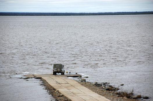 Car at jetty Kolyma river