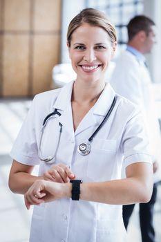 Nurse checking her smart watch