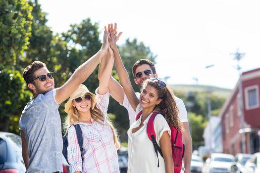 Hip friends doing high-five