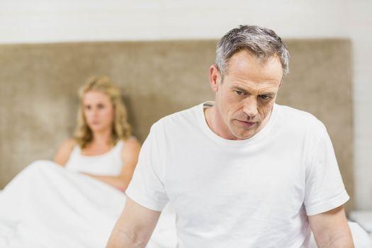 Upset couple sulking each other