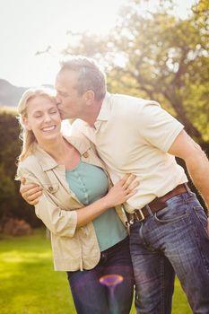 Husband kissing wife on the cheek