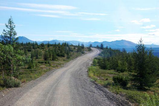 Gravel road at tundra mountains area Chukotka