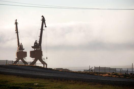 Gravel road near dockside cargo cranes at Pevek town