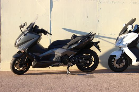 Monte-Carlo, Monaco - January 12 2016: Yamaha TMAX Fourth generation (XP530) Maxi-Scooter, 2012 - 2014. Sport Scooters in Front of the Wall