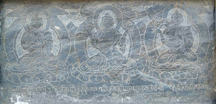 The buddhistic pictures engraved on the stone