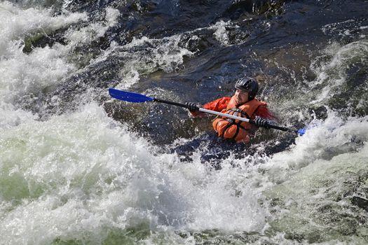 Kayaker in whitewater