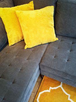 Gray sofa with yellow cushions