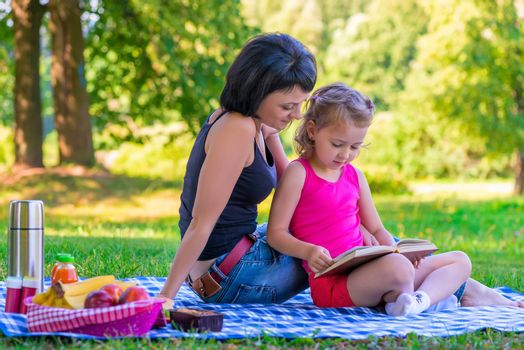 portrait of mother and daughter in the summer park