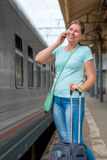 girl at the train station talking on the phone