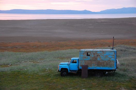 Old broken truck dapted as shed at tundra island