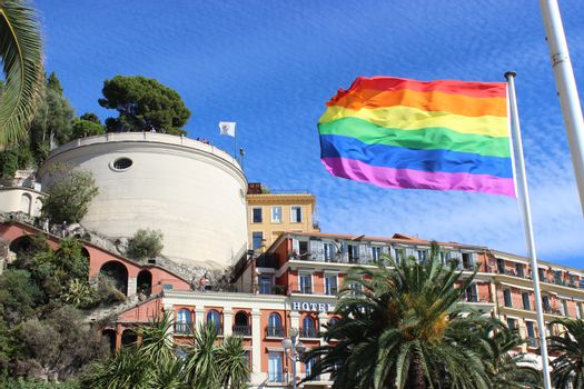 Nice, France - September 18 2015: Rainbow Flag in front of the Nice Castle in Nice, France