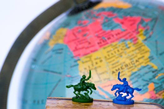 Plastic soldiers in front of a globe