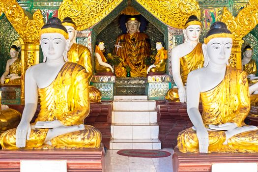 Buddha statues in the Shwedagon pagode in Yangon Myanmar