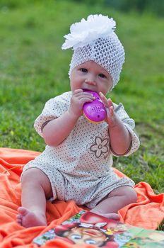 Little girl in cute white hat portrait