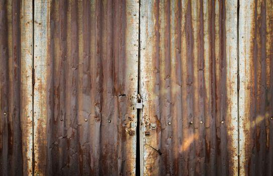 Rusty zinc door lock with key