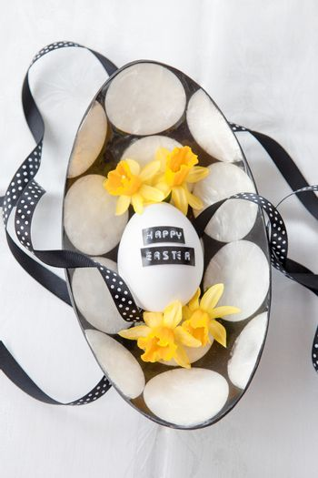 Chicken egg with easter greeting