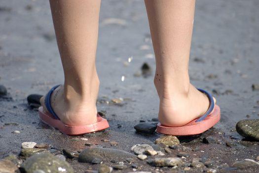 Childish legs on the beach