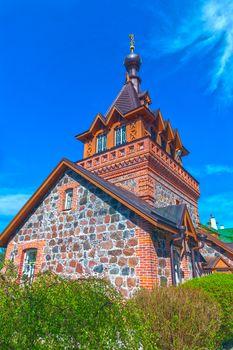 Brick rural Orthodox church in the spring sunny day