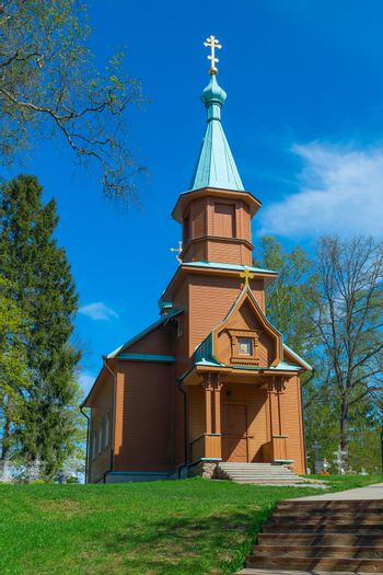 Wooden rural Orthodox church in the spring sunny day