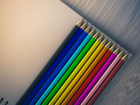 color pencil on checked notebook on wood background